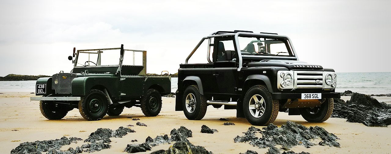 Land Roved Defender on the beach